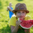 Summer joy - lovely girl eating fresh watermelon in the garden — Stock Photo