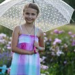Summer rain - happy girl with an umbrella in the rain — Stock Photo