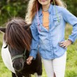 Stock Photo: Ranch - Lovely girl with pony on the ranch