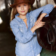 Lovely cowgirl  on a ranch — Stock Photo