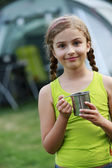 Summer in the tent - young girl on the camping — Stock Photo