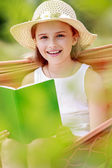 Summer joy, hammock - girl with a book resting on a hammock — Stock Photo