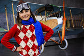 Aviator, happy girl with plane — Stock Photo