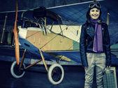 Flying, aviator, plane, travel - girl ready for travel — Stock Photo
