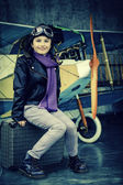 Flying, aviator, plane, travel - girl ready for travel — Stock Photo