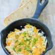 Breakfast, scrambled eggs with chives — Stock Photo #46688817