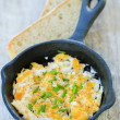 Breakfast, scrambled eggs with chives — Stock Photo
