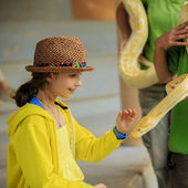 Trip to the Zoo - girl and snake at the Zoo — Stock Photo