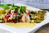 Asparagus - Grilled young asparagus wrapped in prosciutto meat — Stock fotografie