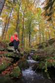 Autumn trek - woman on mountain hike — Stock Photo