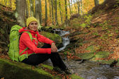 Autumn trek - woman on mountain hike — Stock Photo