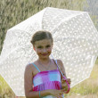 Summer rain - happy girl with an umbrella in the rain — Stok fotoğraf #46804973