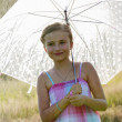 Summer rain - happy girl with an umbrella in the rain — Stok fotoğraf