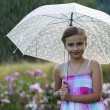 Summer rain - happy girl with an umbrella in the rain — Stock fotografie