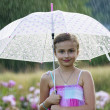 Summer rain - happy girl with an umbrella in the rain — Stock fotografie #46805395