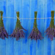Lavender herbs drying on the wooden barn in the garden — Stock Photo #46806037