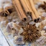 Cinnamon sticks and star anise on brown sugar — Stock Photo #46829817