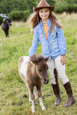 Ranch - Lovely girl with pony on the ranch — Stock Photo
