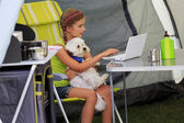Summer camp - young girl with dog playing in the tent — Stock Photo