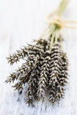 Lavender herbs drying on the wooden table — Stock Photo