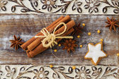 Spices, ginger and anise stars with cinnamon sticks — Stock Photo