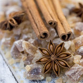 Cinnamon sticks and star anise on brown sugar — Stock Photo