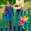Gardening - lovely girl with mother working in flowers garden — Stock Photo #47078059