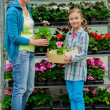 Planting, garden flowers - family shopping plants and flowers in garden center — Stock Photo #47079997