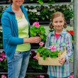 Planting, garden flowers - family shopping plants and flowers in garden center — Stock Photo #47079999