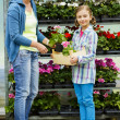 Planting, garden flowers - family shopping plants and flowers in garden center — Stock Photo #47080003