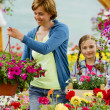 Planting, garden flowers - family shopping plants and flowers in garden center — Stock Photo #47080789