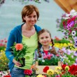 Planting, garden flowers - family shopping plants and flowers in garden center — Stock Photo #47080801