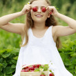 Strawberry time - young girl with picked strawberries — Stock Photo #47084991