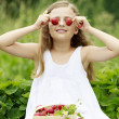 Strawberry time - young girl with picked strawberries — Stock Photo #47085037