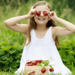 Strawberry time - young girl with picked strawberries — Stock Photo #47085039