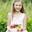 Strawberry time - young girl with picked strawberries — Stock Photo #47085053
