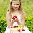 Strawberry time - young girl with picked strawberries — Stock Photo #47085087