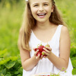 Strawberry time - young girl with picked strawberries — Stock Photo #47085173