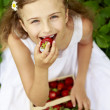 Strawberry time - young girl with picked strawberries — Stock Photo #47085221
