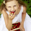 Strawberry time - young girl with picked strawberries — Stock Photo #47085273