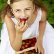 Strawberry time - young girl with picked strawberries — Stock Photo #47085327