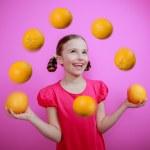 Grapefruit, healthy eating - a young girl juggling grapefruits — Stock Photo #47085435