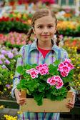 Planting, garden flowers - girl shopping plants and flowers in garden center — Stock Photo