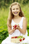 Strawberry time - young girl with picked strawberries — Stock Photo
