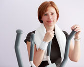 Training, fitness - woman at the gym on a crosstrainer — Stock Photo