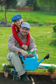 Gardening, planting - young girl helping father in the garden — Stock Photo