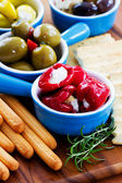 Mediterranean cuisine - antipasti and grissini, appetizer — Stock Photo
