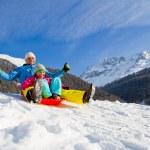 Winter fun, snow, family sledding at winter time — Stock Photo #47436697