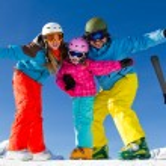 Ski, winter, snow, skiers, sun and fun - family enjoying winter — Stock Photo #47438503