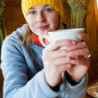 Apres ski, winter holiday - young snowboarder girl resting in mountain hut — Stock Photo #47439079